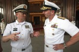 Adm. Wu Shengli, left, speaks with U.S. Chief of Naval Operations Adm. Jonathan Greenert